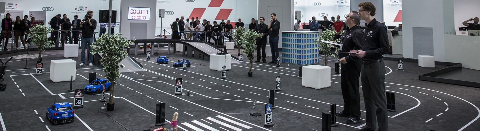 A contest between high-tech models to develop autonomous driving
